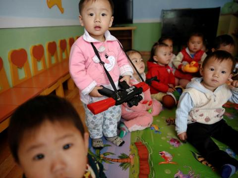 Children play in the kindergarden at Jangchon Vegetable Co-op farm outside of Pyongyang.