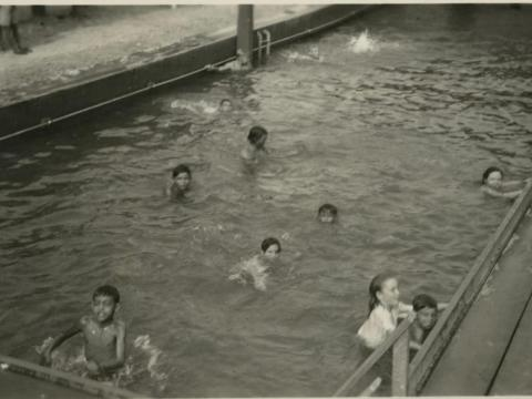 He also gave them access to amenities and resources while employed in the settlement, like a swimming pool ...
