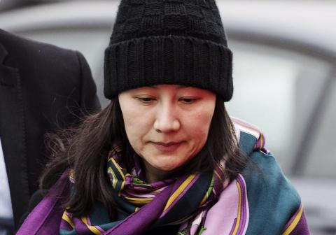 Huawei's chief financial officer, Meng Wanzhou, arriving at a parole office with a security guard in Vancouver, British Columbia.