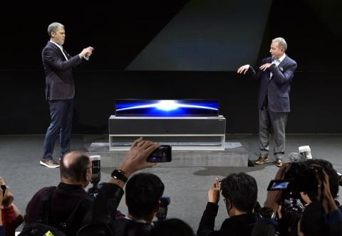LG unveils its futuristic Signature OLED TV that rolls-up with the press of a button.