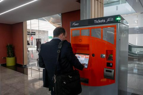 The machines are easy enough to use. Anyone who has visited a major city and used the metro system can figure it out. It accepts cash and credit cards.
