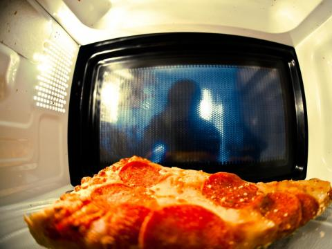 Your pizza will lose its crunch in the microwave.