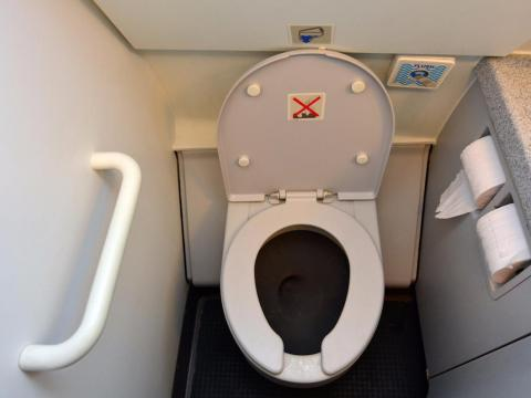 Not flushing the toilet