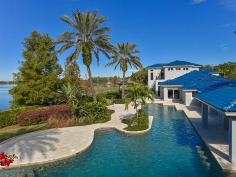 The outside is just as impressive, with a 95-foot-long, 15-foot-deep swimming pool and waterfall, space for barbecuing, and a cabana.