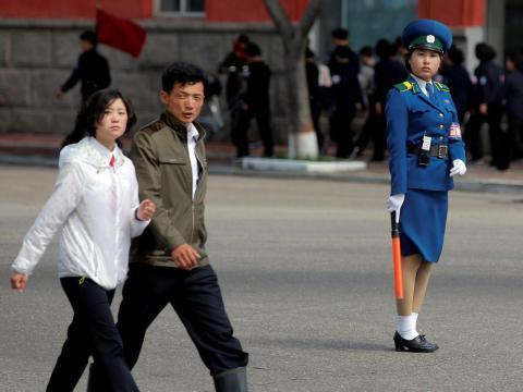 People cross the street in central Pyongyang.