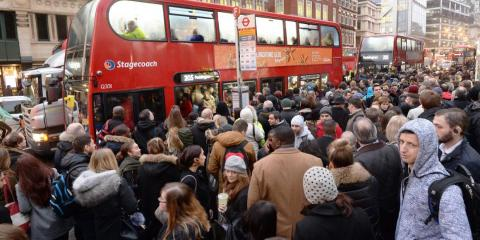 People queue for buses at Bishopsgate in the City of London, as Underground workers in the capital continued a 24-hour strike which crippling Tube services and causing travel chaos for millions of passengers.