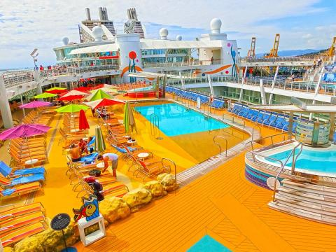 The pool deck of a cruise ship can be the perfect place to relax and work on your tan.
