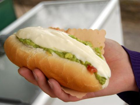 "Shayanne Gal, a graphic designer at Insider Inc., has lived in Santiago, Chile, and told INSIDER that a completo — a hot dog topped with avocado, tomato, and mayo — is a ""staple late-night food."""