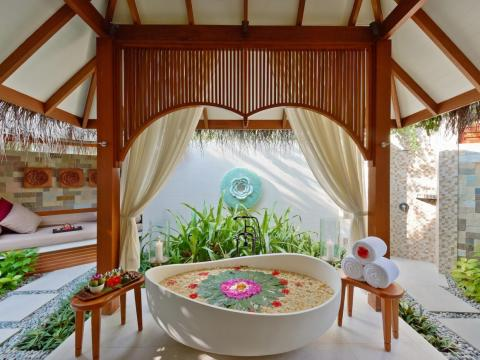 A steam bath and outdoor relaxation area with bathtub and rainfall shower in a tropical garden is included with every suite.