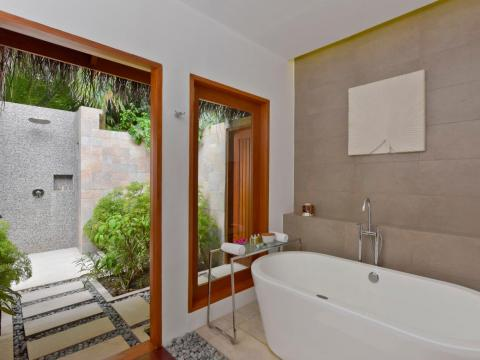 ... with their spacious soaking tubs and outdoor rain showers.