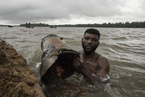 "6. Sand divers in Cameroon retrieve around 1.7 tonnes of sand each in a roughly three-hour shift. ""The work was brutal and dangerous and the miners dived around the low tide."" Deaths occurred during Brown's time there in 2017,"
