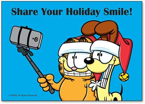 Garfield y Oddie, en una viñeta de Jim Davis