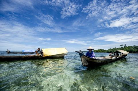 """Bajau traditionally live on handmade """"lepa-lepa"""" boats, bringing everything they need to sea, including cooking utensils, kerosene lamps, food, water, and even plants. They come to shore only to trade or fix their boats."""