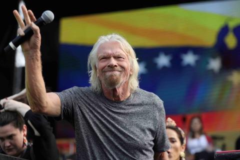 Richard Branson con bandera de Venezuela.