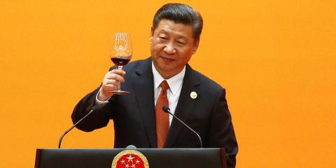 Chinese President Xi Jinping makes a toast in Beijing in May 2017. Under his rule, the Chinese Communist Party has pushed out a social credit system that aims to reward and punish citizens according to their behavior.