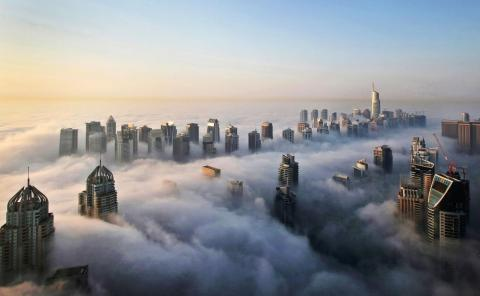 Buildings poke through clouds in Dubai.
