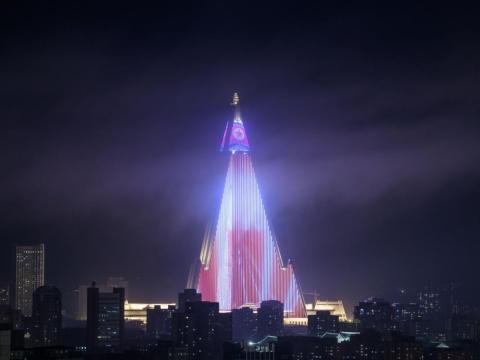Propaganda lit up on the Ryugyong Hotel.
