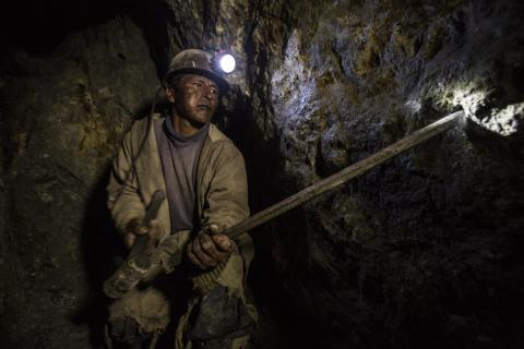 """Everyone that I spoke with had lost family members and friends to work on that mountain,"" Brown said. ""Everyone."" In this 2016 photo, a miner chisels out holes for dynamite."
