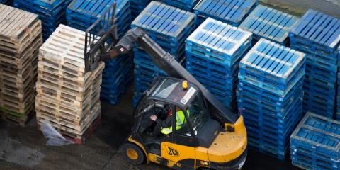 A forklift truck moves wooden pallets at the Port of Southampton in Southampton, England, on February 10.