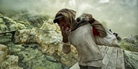 A miner in Bolivia's Cerro Rico silver mines, where millions have died since the 1500s.