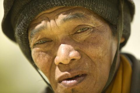 "Sulfur particles adorn the eyes and face of this miner in this 2012 photo. ""These men were amongst the strongest men that I have ever seen,"" Brown said."