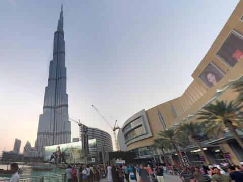 Towering over the city, at 2,717 feet tall with 160 floors, the Burj Khalifa is the tallest tower in the world. It's a marvel to look at from below.