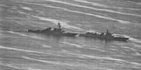 US Navy photo showing a confrontation between the USS Decatur (left) and PRC Warship 170 (right) in the South China Sea on Sunday, September 30, 2018.