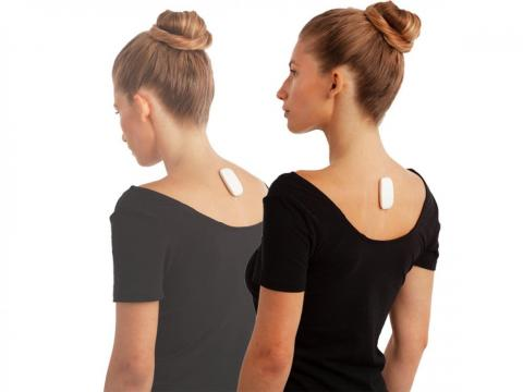 Use an app-enabled buzzing posture trainer