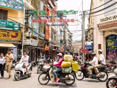 #15: Hanoi, Vietnam, is full of beautiful sights and enticing food whether you travel on foot, by bike, or in vintage vehicles.