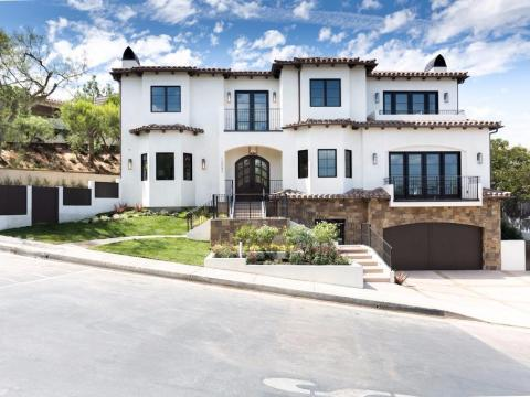 The 6,000-square-foot, three-story Spanish-style residence sits on a quarter-acre lot in a gated community.