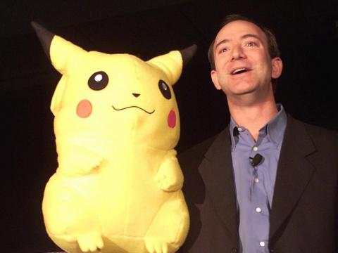 Jeff Bezos with a Pikachu doll.