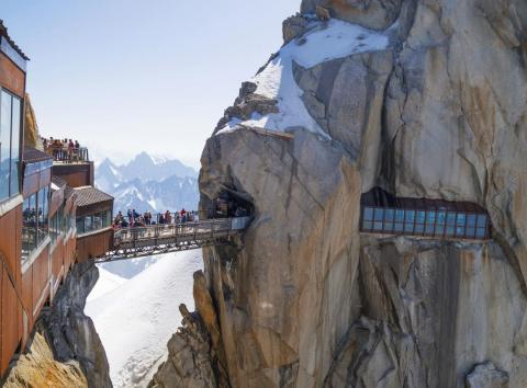 The Aiguille du Midi bridge in the French Alps is accessible by cable car.