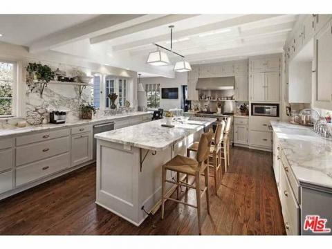 ... and a kitchen with marble accents.