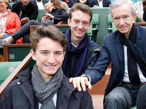 Jean Arnault (front left) with his brother, Frederic (center) and father, Bernard (right).