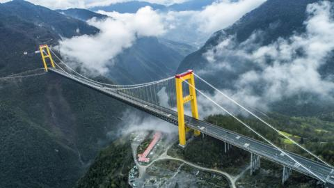 Construction workers had to use a rocket to build the suspension cable on China's Sidu River Bridge.