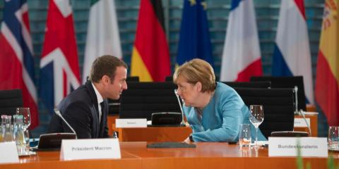 German Chancellor Angela Merkel and French President Emmanuel Macron at a meeting for EU leaders in Berlin i June 2017. Germany and France have been concerned with China's economic policies with the EU.