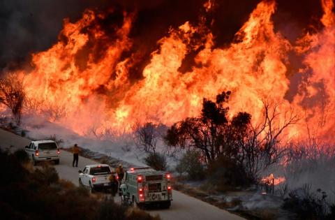 Fire fighters battle the Thomas Fire near Ojai, California on December 9, 2017.