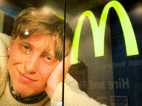 """A picture of Bill Gates with the McDonald's logo on display in 2014 at an exhibit called, """"The American Way. The USA in Germany."""""""