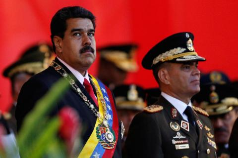 Venezuelan President Nicolas Maduro at a military parade to celebrate the 195th anniversary of the Battle of Carabobo, next to Venezuelan Defense Minister Vladimir Padrino Lopez, in Caracas, June 24, 2016.