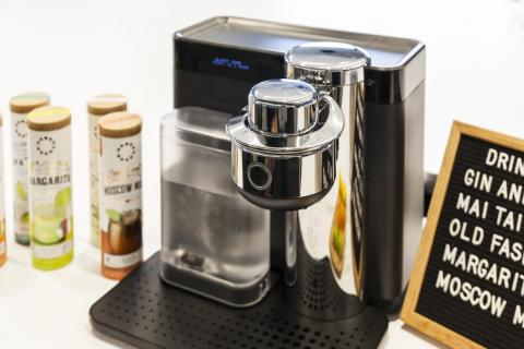 The machine is used to add the correct amount of water or sparkling water to create a beverage.