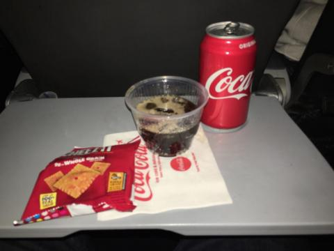 For the most part, in-flight dining in economy class means a soda and a snack.