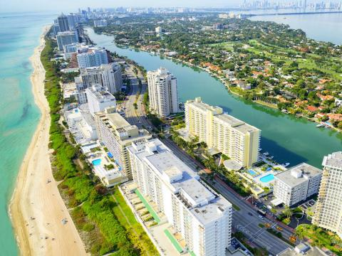 Rich people from high-tax states like New York and California are moving to the Miami area to take advantage of Florida's status as a no-income tax state.