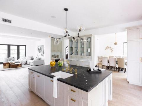 The floors are brushed oak, and the kitchen — which opens out onto a veranda — has marble countertops.