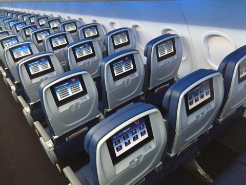 These days more airlines either offer free-streaming entertainment options or personal in-flight entertainment systems.