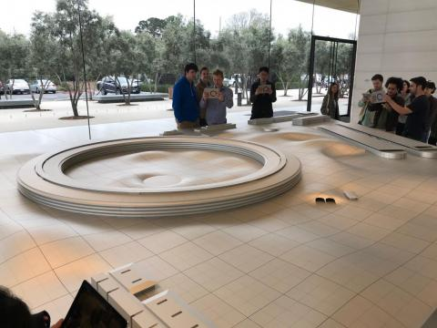 You can also see a scale model of the spaceship building and surrounding campus.
