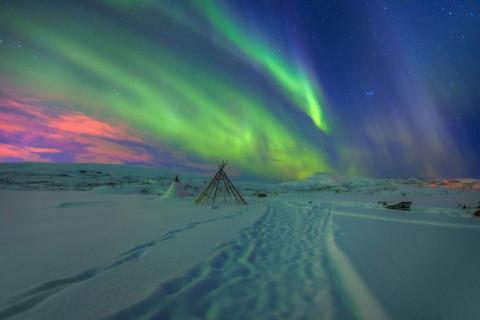 Una foto de las luces del norte en Tromsø, Noruega.