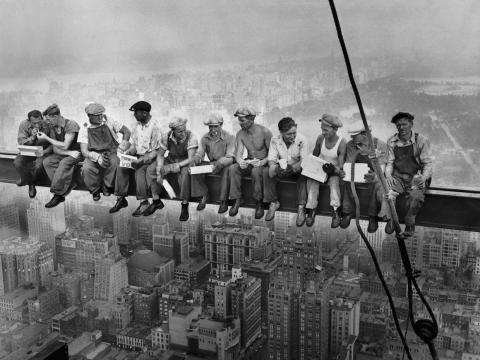 1932: This image of 11 construction workers sitting on a beam of what is now the GE Building 850 feet above New York City began as a publicity stunt but became an iconic early symbol of the building boom at the height of American