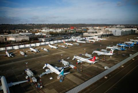 An aerial photo shows Boeing airplanes, many of which are grounded 737 MAX aircraft, at Boeing Field in Seattle, Washington.