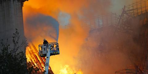 A firefighter at Notre-Dame on Monday night. The fire was fully extinguished on Tuesday morning.
