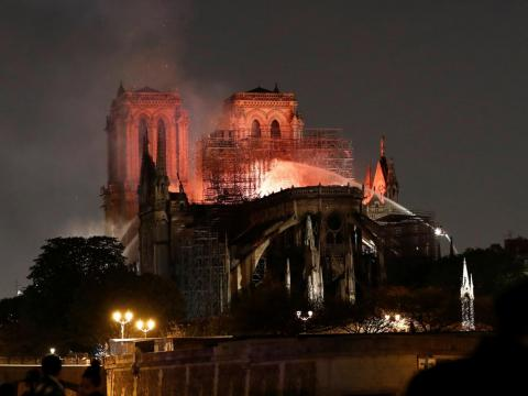 Firefighters douse flames from the burning Notre-Dame Cathedral on Monday.
